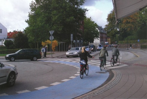 Roundabout, Lyngby, Denmark, with blue-painted bike lane. Photo by Ryan Snyder from 2011 Association of Bicycle and Pedestrian Professionals calendar