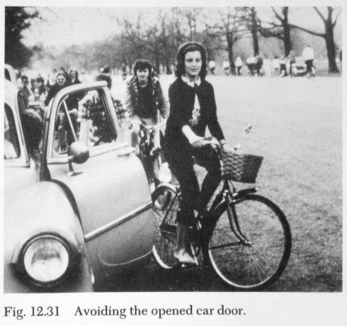 DeLong's photo illustrating avoidance of an opening car door.