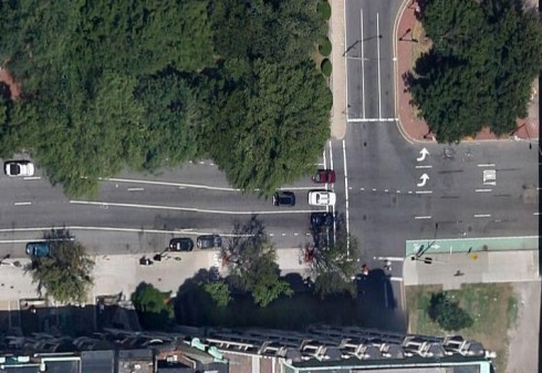 Transition from bike lane to no bike lane to bike lane at right edge. Note, no shared-lane markings yet in this aerial view (Google Maps aerial view)