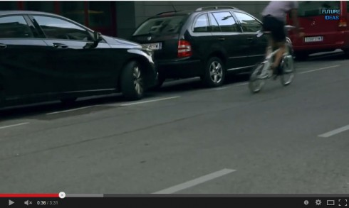 Bicyclist riding in door zone in flipped image