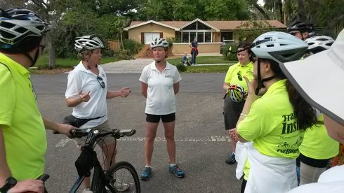 "CyclingSavvy Instructor Training, March 4, 2017. Instructor Trainers keri Caffrey and Lisa Walker debrief instructor candidates following a ""feature"" -- a ride through a demanding stretch of roadway."